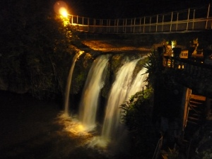 "Paronella""s Falls at night, lit up by their own hydro scheme."