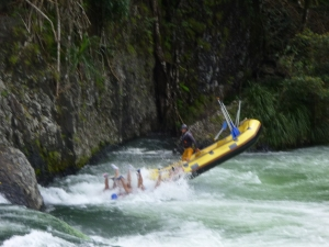 """The guide having fun catapulting his unsuspecting """"crew"""" into the rapids after coming down a 3m fall."""