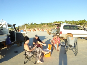 Sausage sizzle on Cable Beach with our friends.......and the sunset camel tour behind