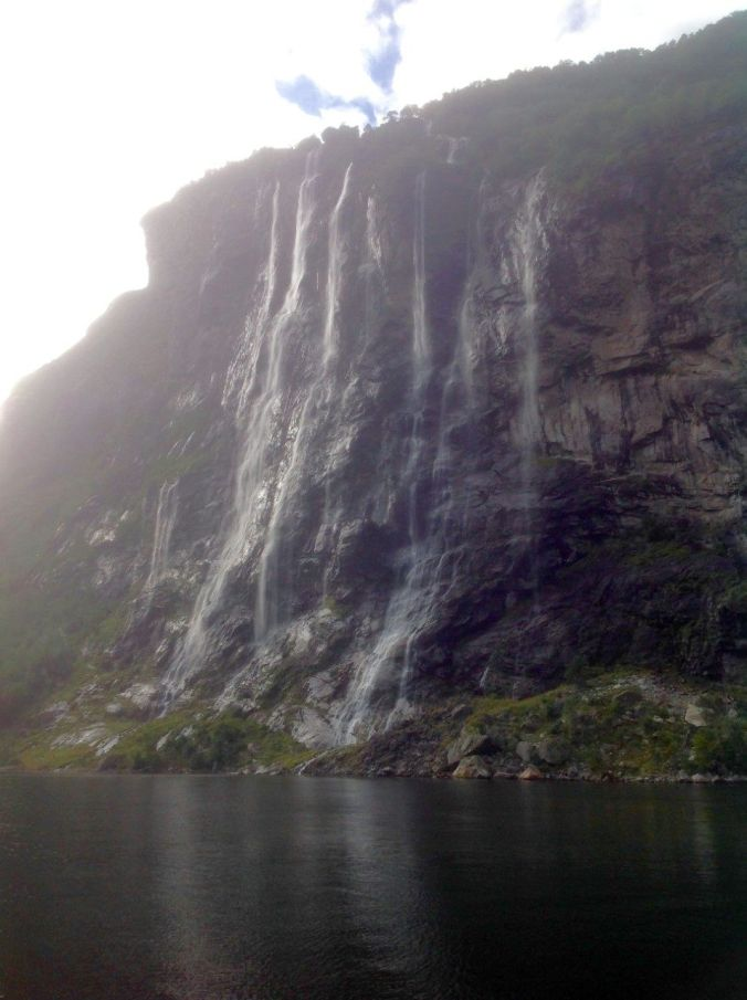 Seven Sisters waterfall tumbling down the rock face on the Geiranger Fjord.