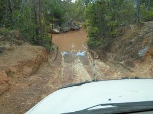 Steep and slippery entry to Scrubby Creek with water over the bonnet assured and a steep exit to follow