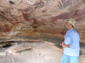 Indigenous guide showing us over Quinken rock art dating back.......34,000 years.