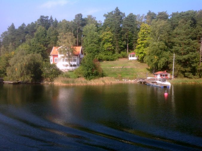 Views in the archipelago. Many large homes but with wooden cottages side by side. The archipelago spreads 80 kms into the Baltic Sea.