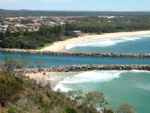 Estuary inlet at Evans Head. Caravan Park in the trees to the left of the Surf Club